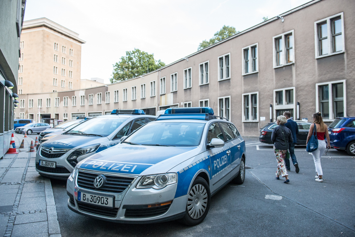 police cars in Berlin. The club Mensch Meier claims the police and the customs office used excessive force in an coordinated operation at the venue.