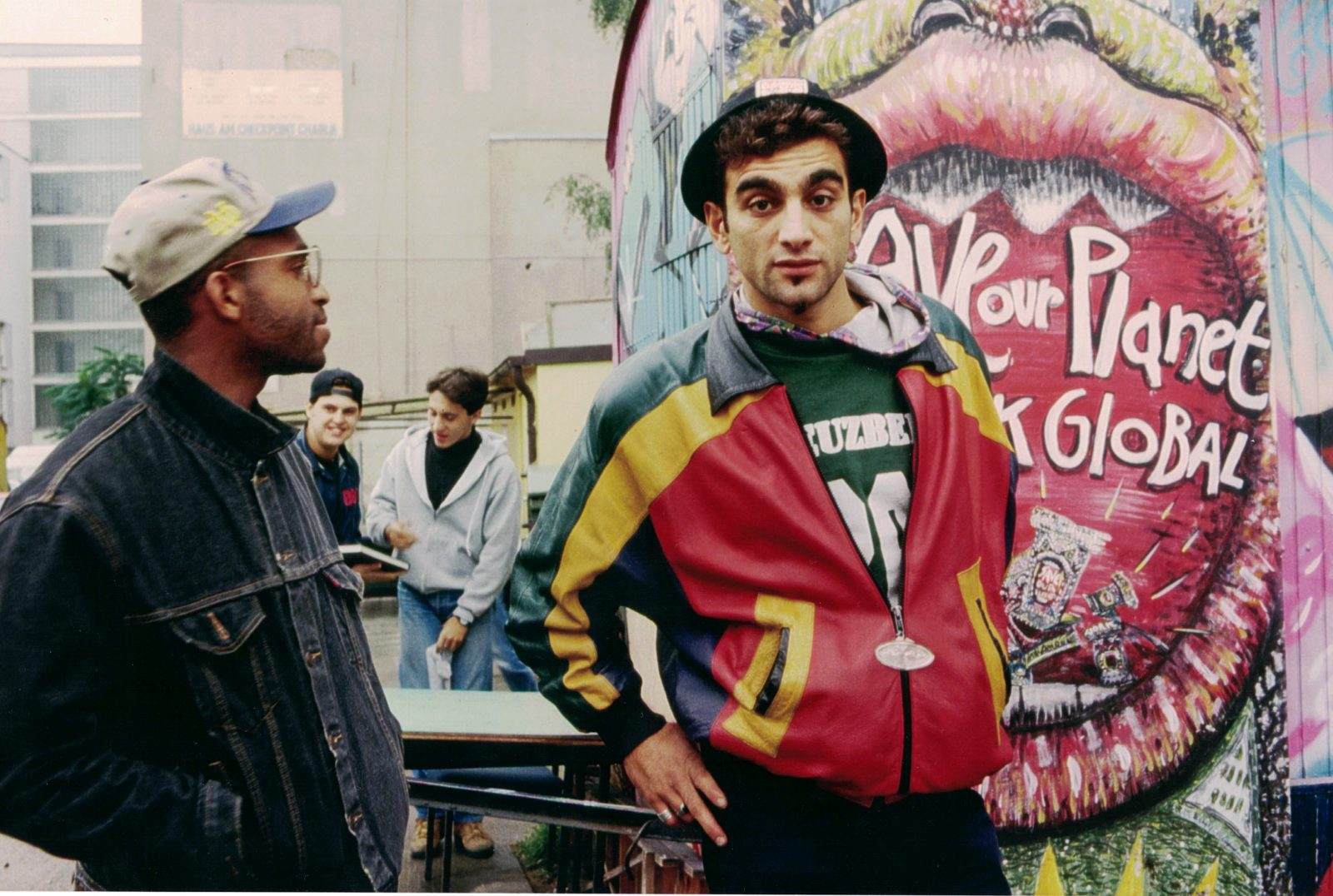Graffiti artists Jayone and Giò in front of a graffiti in the early Nineties. The artists were activists against racism.