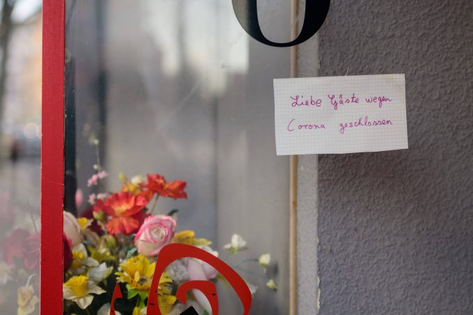 March 21, 2020: A handwritten note with the writing Dear guests closed because of Corona Liebe Gaeste wegen Corona geschlossen is hanging at a window of a sex cinema in the Berlin district of Schˆneberg while the Governing Mayor of Berlin, Michael Mueller SPD, prepares restricting residents movements to contain the deadly coronavirus pandemic. Public venues such as bars, clubs, museums, cinemas, schools, daycare centers and universities have already closed. Many businesses are resorting to home office work for their employees. And travel across the border to most neighbouring countries is severely restricted. - ZUMAs172 20200321zaps172003 Copyright: xJanxScheunertx
