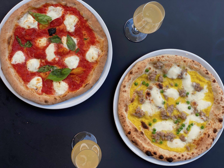 Pizza und Bellini: Sironi La Pizza ist keine klassische Pizzeria, sondern experimentiert mit verschiedenen Teigen und Belag wie Safrancrème oder Austernpilze.